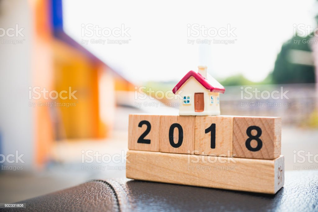 Mini colorful house and year 2018 wooden block stock photo