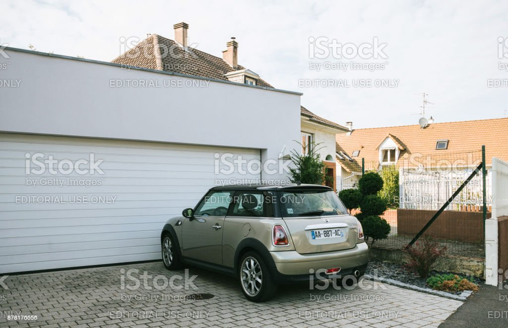 Mini cooper car parked in front of house stock photo