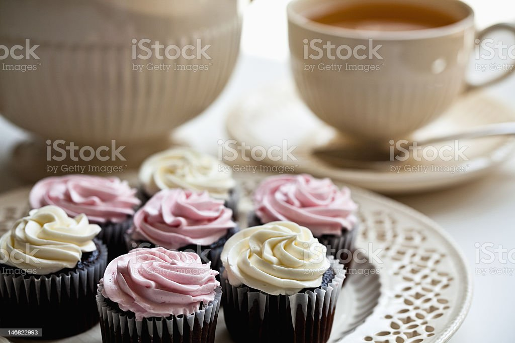 Mini cupcakes and tea cups at tea time royalty-free stock photo