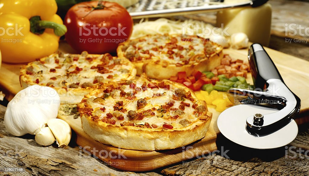 Mini Deep Dish Pizzas with Fresh Ingredients royalty-free stock photo
