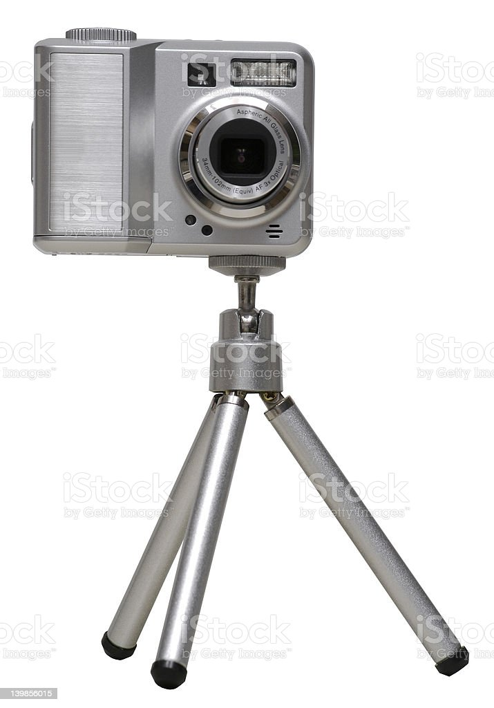 Mini Digital Camera on a Tripod - Isolated royalty-free stock photo