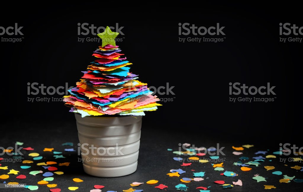 Mini DIY Paper Tree Christmas Decoration on black background