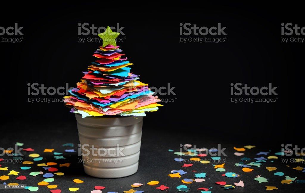 Mini DIY Paper Tree Christmas Decoration on black background