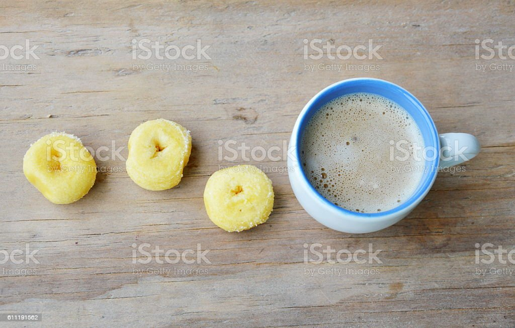 mini donuts and milk coffee cup
