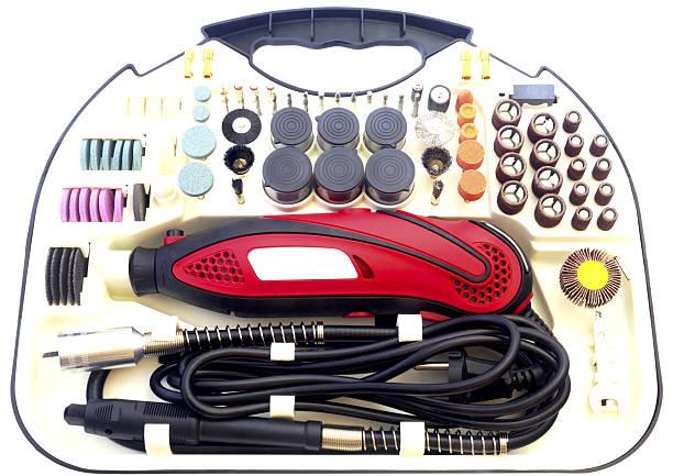 mini drill machine with set of accessories isolated in white - dremel zubehör stock-fotos und bilder