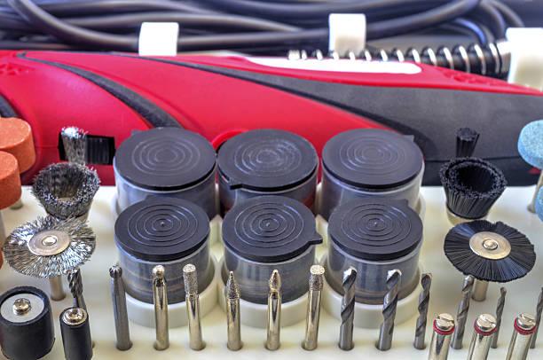 mini drill machine with set of different accessories - dremel zubehör stock-fotos und bilder
