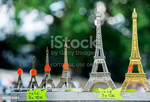 istock Paris, France- June 30, 2013:Mini eiffel towers in single shop of Paris. It's a tipical souvenir you can find in every single shop of Paris 641116084