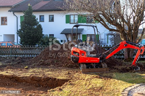 Conventional crawler excavator digging a pit without a driver