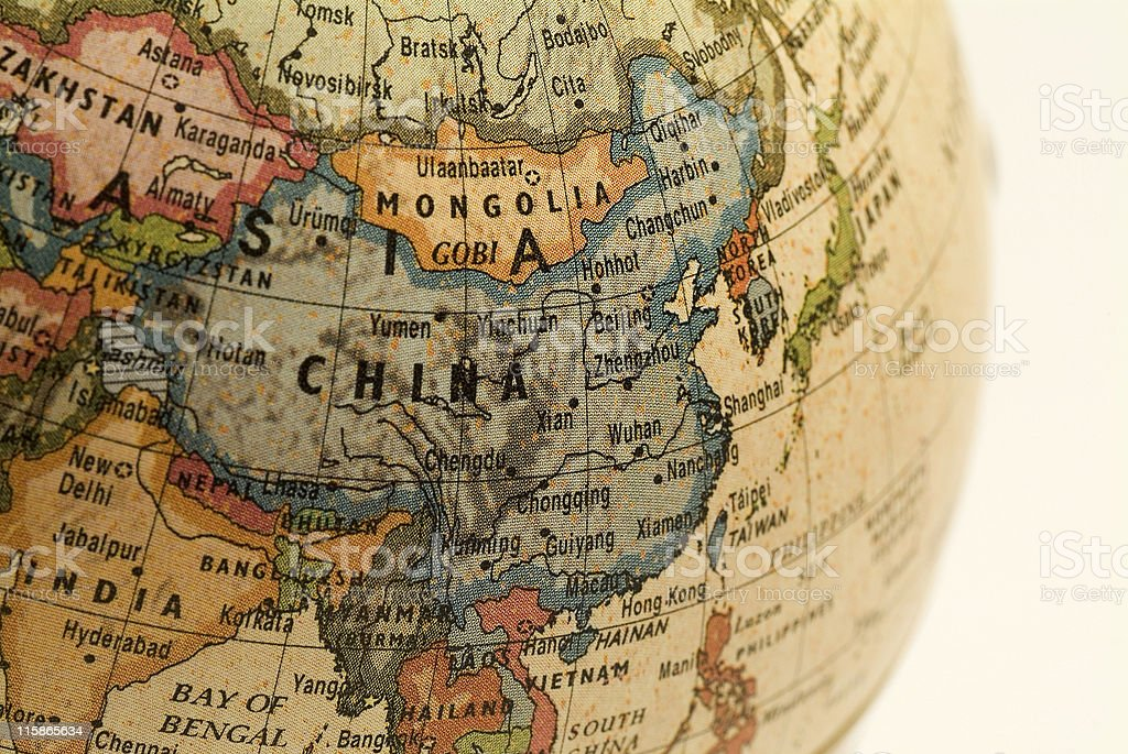 A mini globe focusing in on China royalty-free stock photo