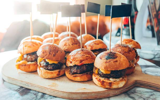 mini hamburgers - sliding stock photos and pictures