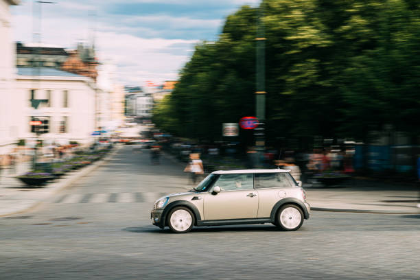 Mini Hatch Second generation R56 Fast Driving In City Street stock photo