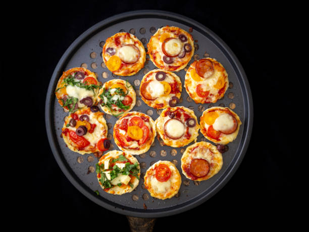 Mini hemlagad pizza Bites bildbanksfoto