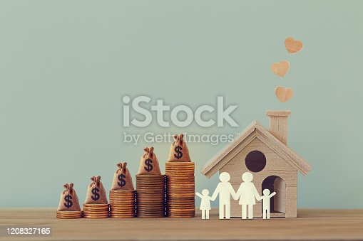 Mini house and heart, family members, US money bags on rows of rising coins on table. Family tax benefit, residential property tax concept: depicts home equity loan, real estate business investment.