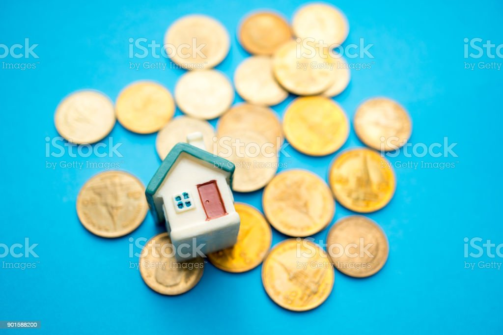 Mini house and stack coins stock photo