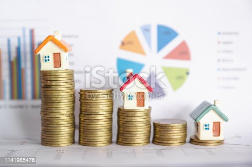 Mini house on stack of coins,Money and house,  Mortgage, Savings money for buy house and loan to business investment for real estate concept. Invesment and Risk Management.