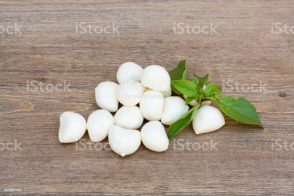 Mini mozzarella balls with green basil leaves royalty-free stock photo