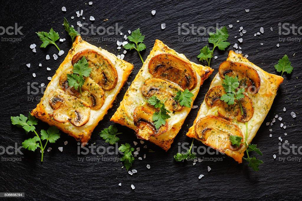 Mini mushroom tarts with puff pastry stock photo