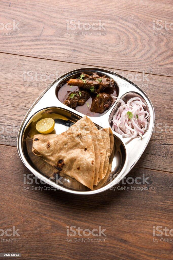 mini muttongosht curry thali with chapatiroti popular indian