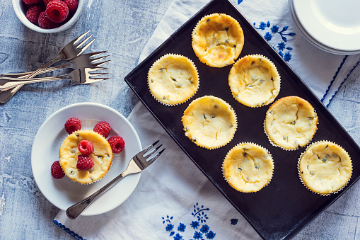 Mini Passionfruit Cheesecakes with Raspberries