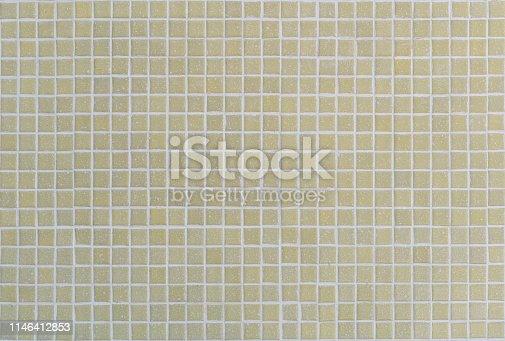 Small matte yellow ceramic mosaic square seamless tile background - Mini porcelain retro lime tiles texture with white grout