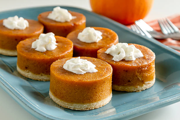 Mini Pumpkin Pies for Holiday Celebrations stock photo