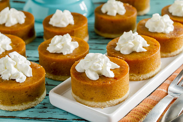 Mini Pumpkin Pies for Holiday Celebrations stock photo