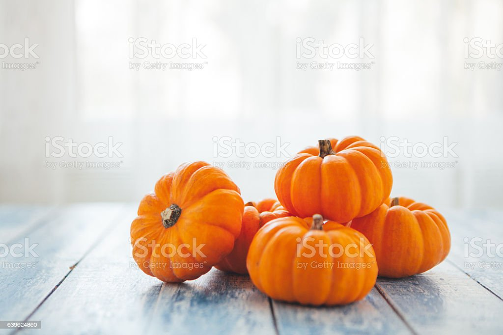 Mini pumpkins on a rustic wooden table stock photo