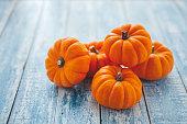 Mini pumpkins on a rustic wooden table