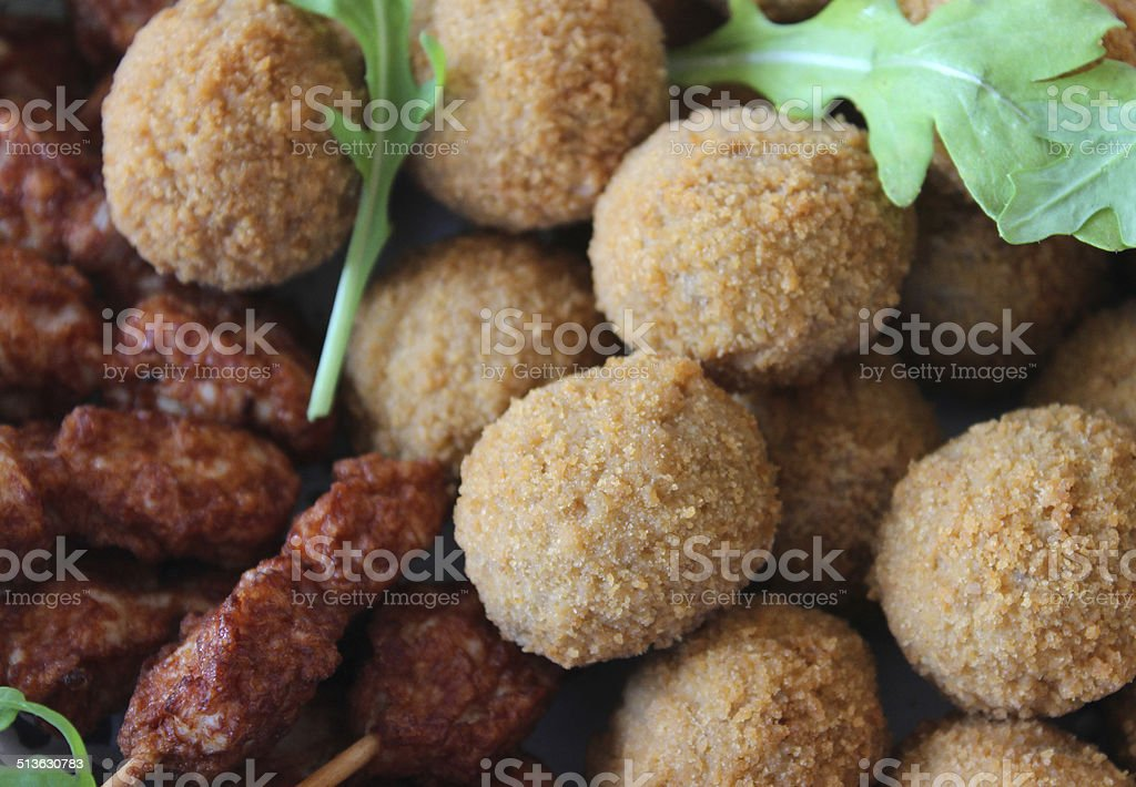 Mini Scotch eggs and chicken satay sticks, party food buffet stock photo