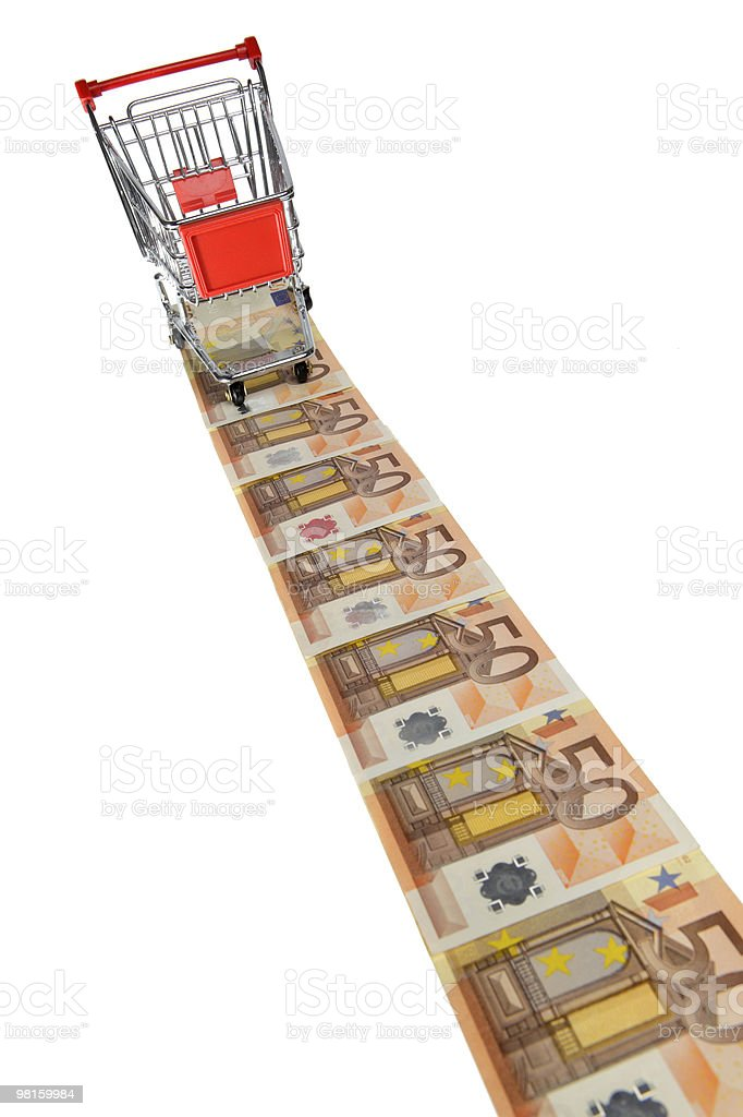 Mini shopping cart on a line of euro banknotes royalty-free stock photo