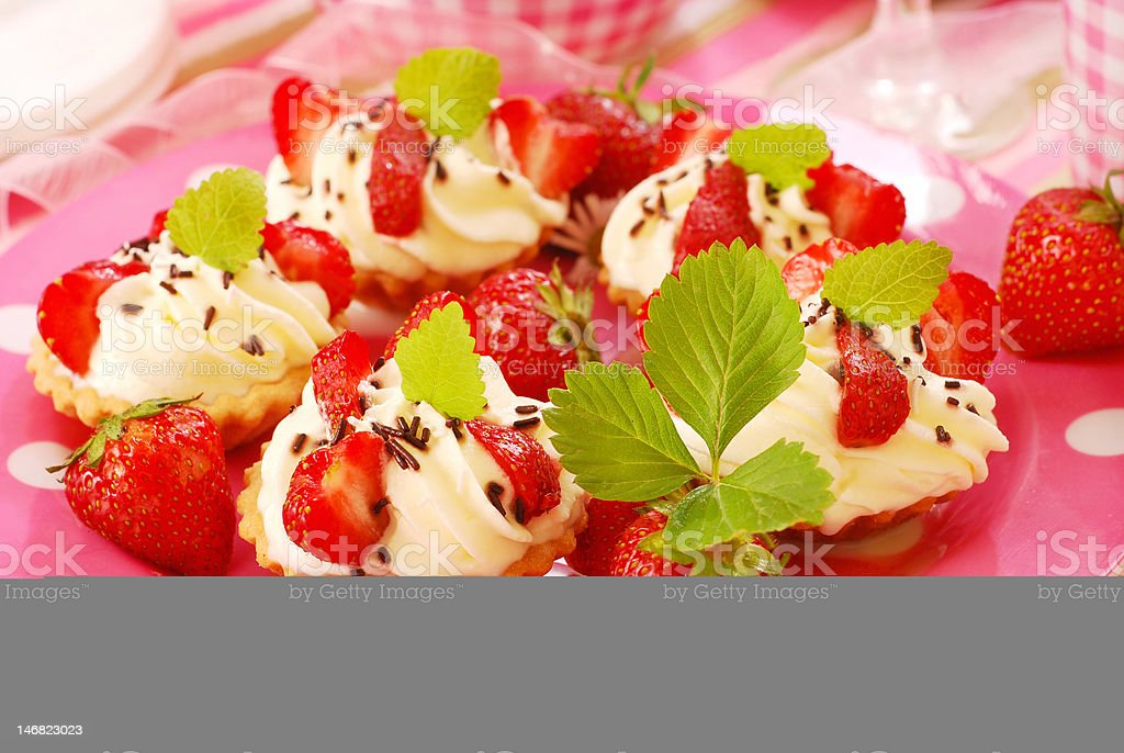 mini tartlets with whipped cream and strawberry royalty-free stock photo