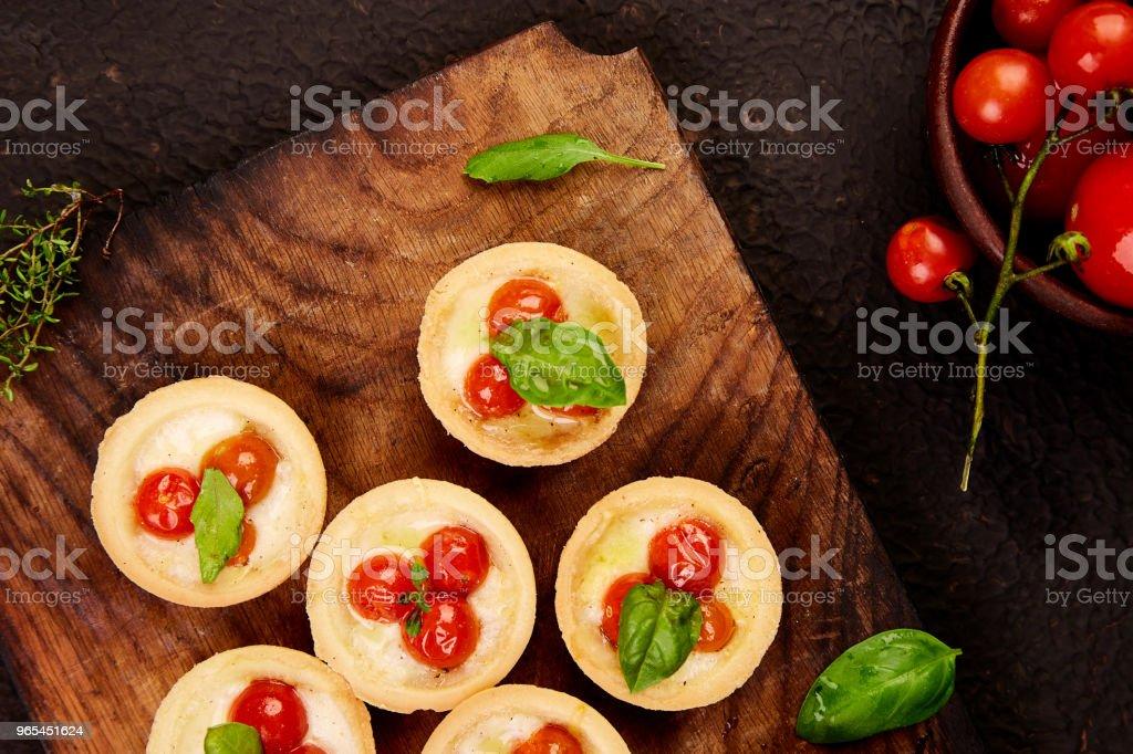 Mini tarts with cherry tomatoes zbiór zdjęć royalty-free