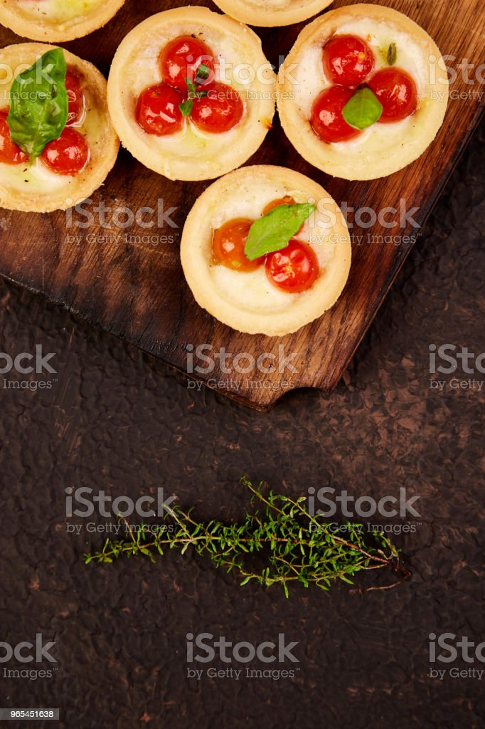Mini tarts with cherry tomatoes royalty-free stock photo