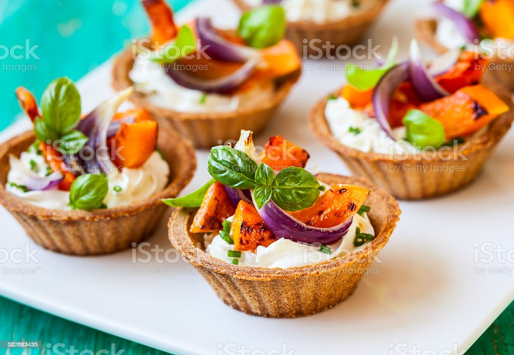 mini tarts with pumpkin stock photo
