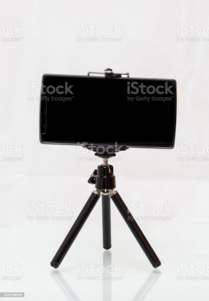 Mini Tripod with smartphone stock photo