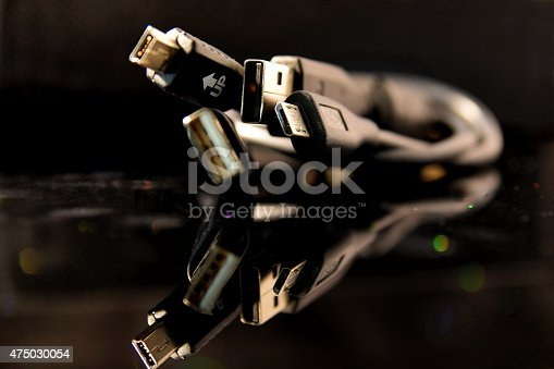 istock Mini USB and USB Cable reflected on the glass 475030054
