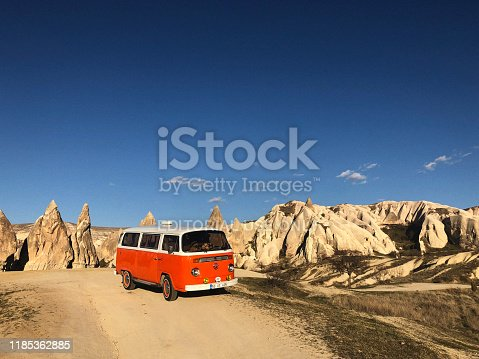 Parked model T2 Volkswagen Van to camp in front of the Fairy Chimneys, Cappadocia, Turkey.