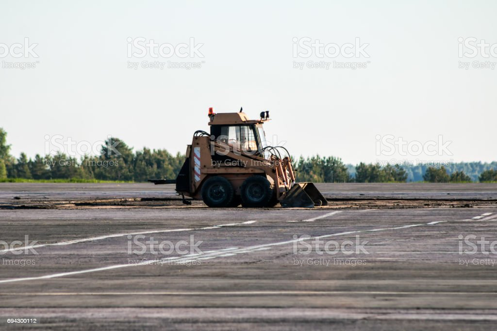 Mini wheel loader at the airfield stock photo