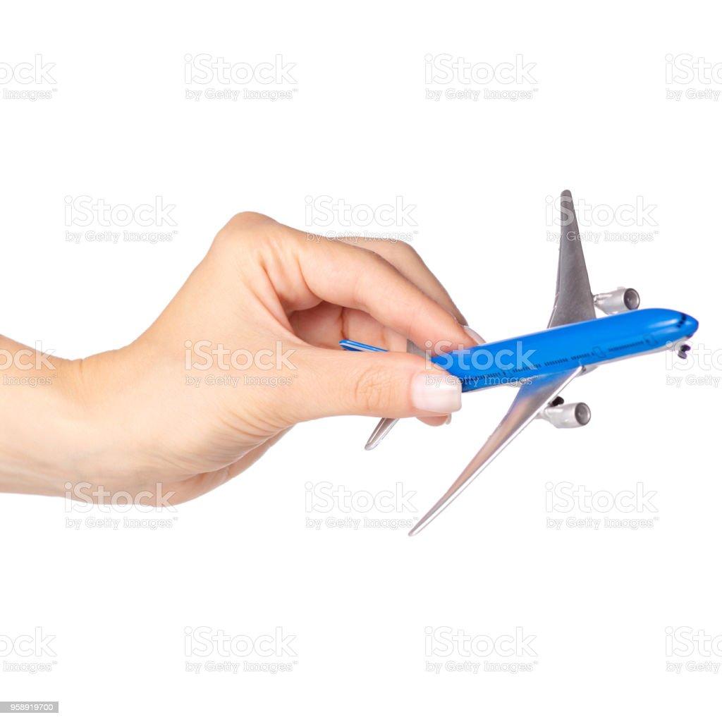 Miniature airplane in hand travel stock photo