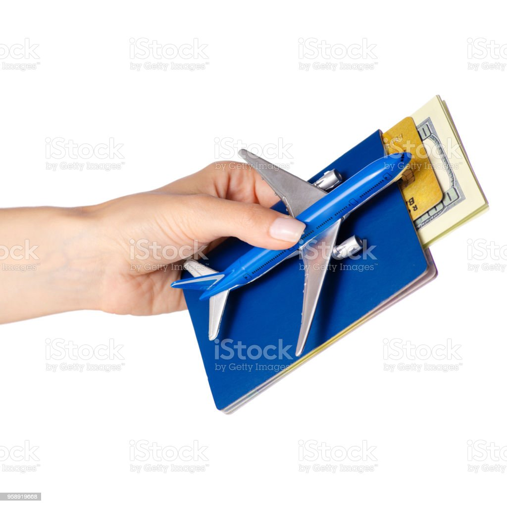 Miniature airplane international passport money dollars payment card in hand travel stock photo
