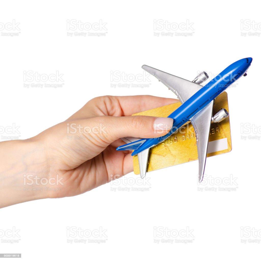 Miniature airplane international passport payment card in hand travel stock photo