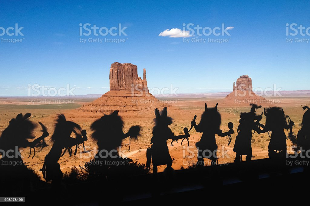 Miniature backlit silhouettes of Native Indian stock photo