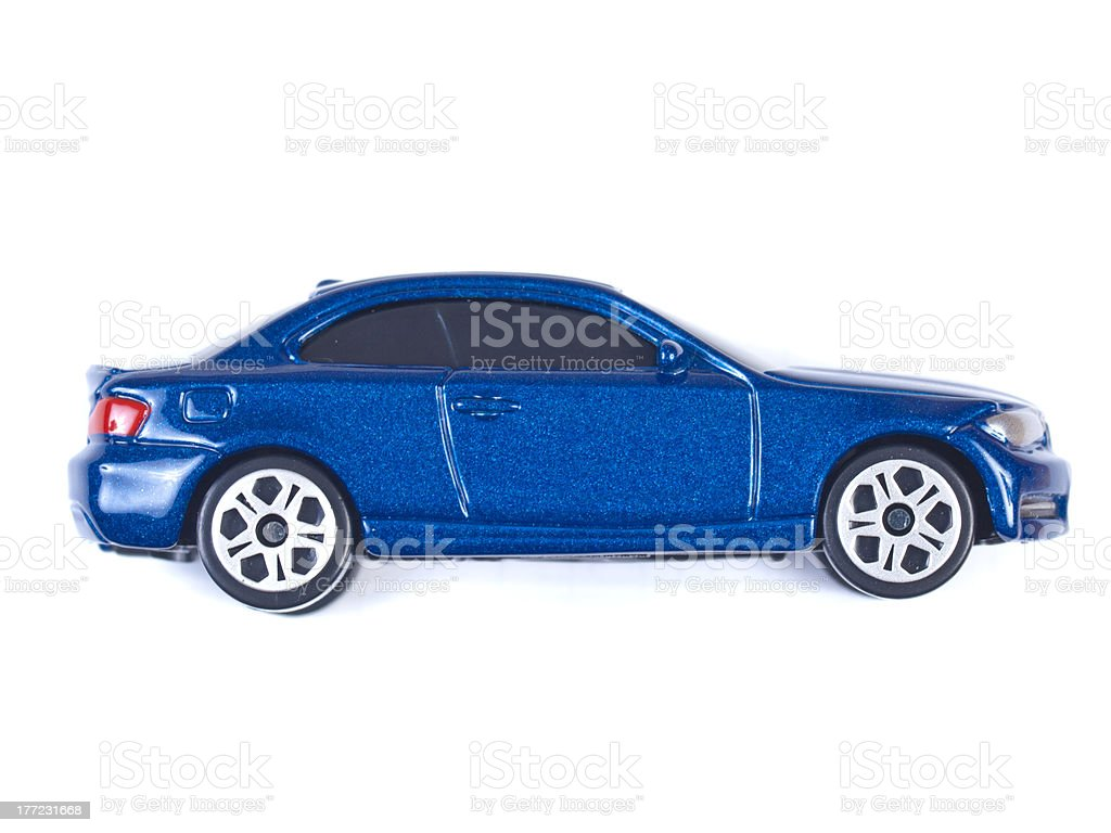 Miniature blue toy car on white background stock photo