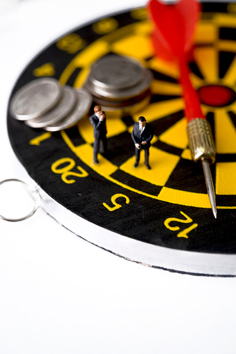 Miniature Business Man Standing On Dart Game Board Planning And Thinking Stock Photo - Download Image Now