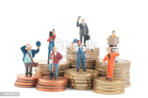 istock Miniature business people on stacks of coins 155369212