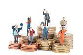 little business people on coins. Job and money. Worker employees with different wage