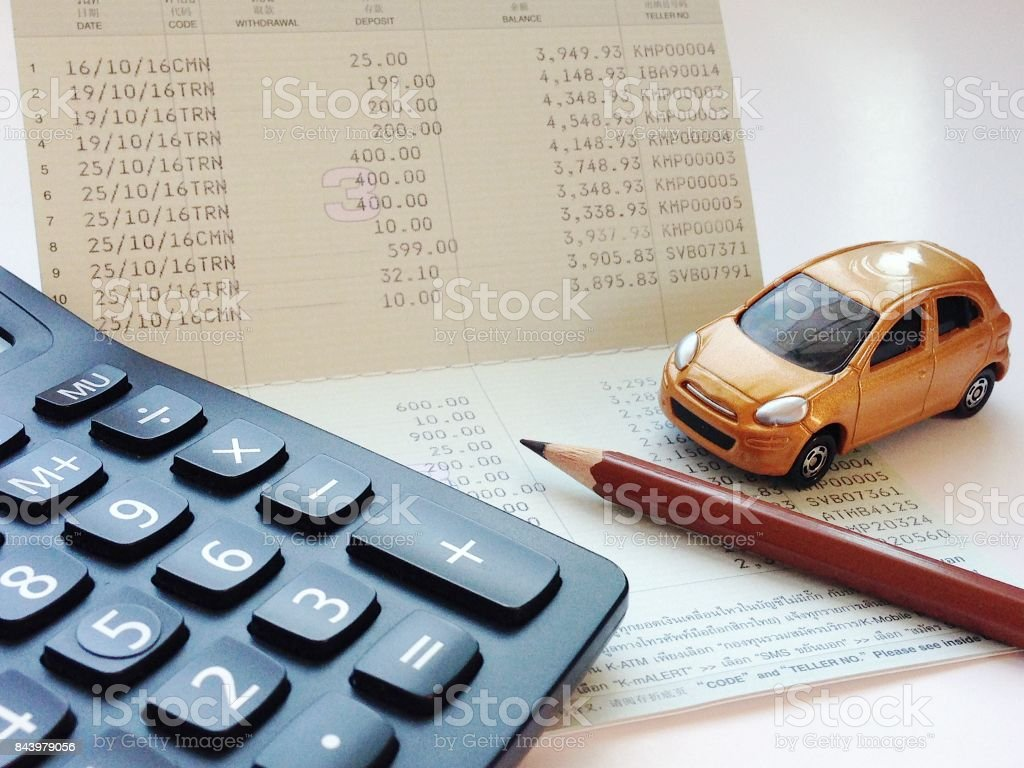 miniature car model calculator and saving account book or financial
