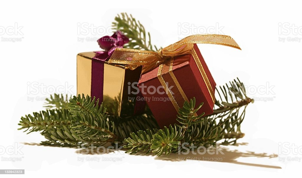 Miniature Christmas presents on Christmas tree branch royalty-free stock photo
