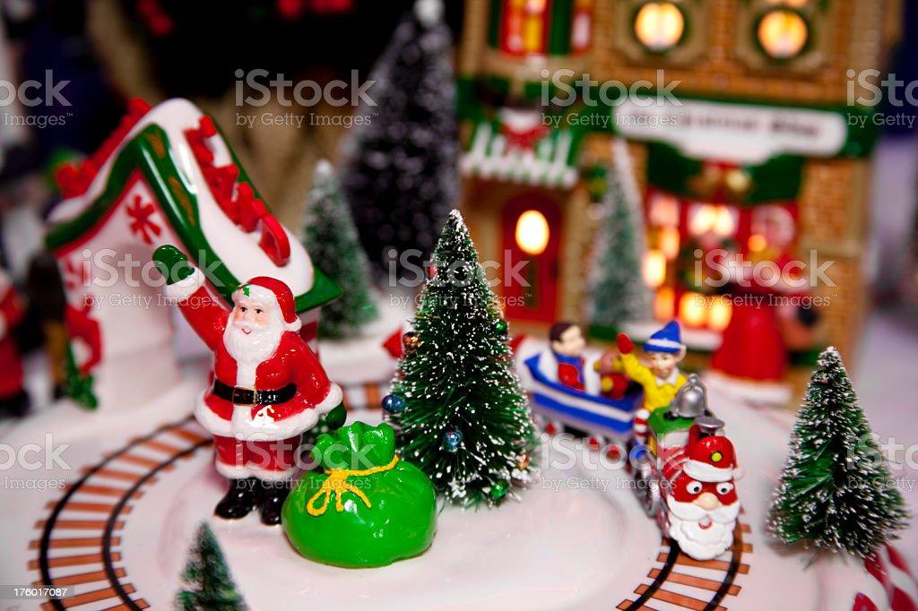 Miniature Christmas scene with Santa and toy bag  train stock photo