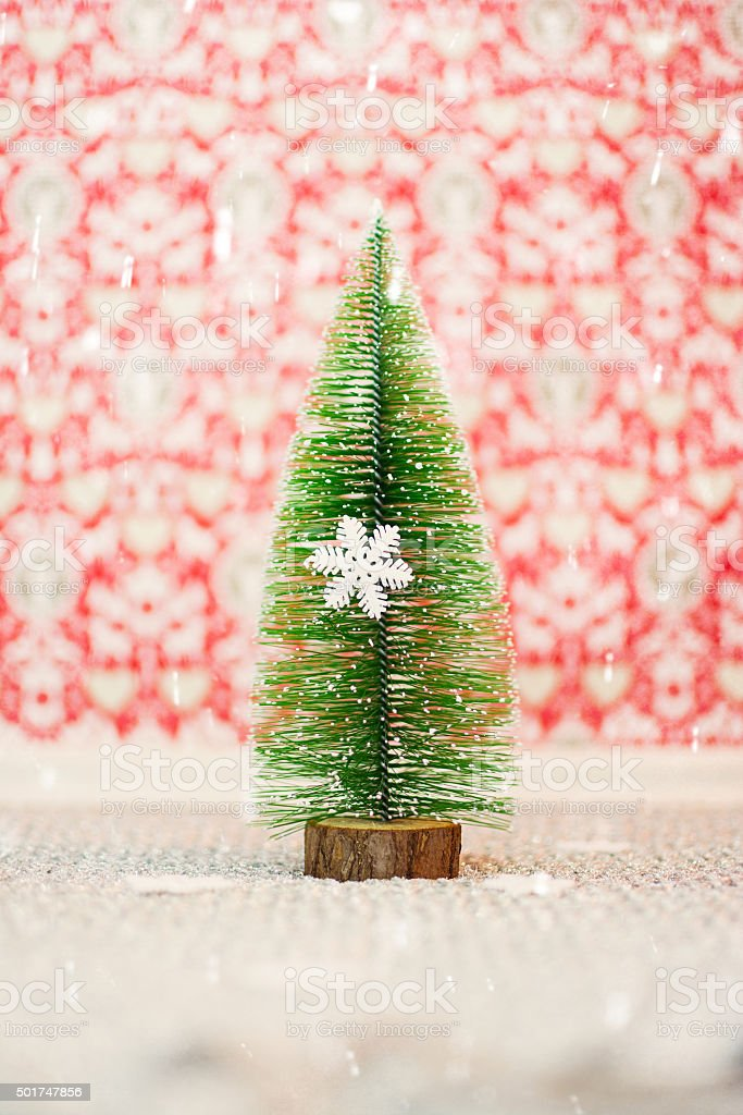 miniature christmas tree and snowflake decoration royalty free stock photo